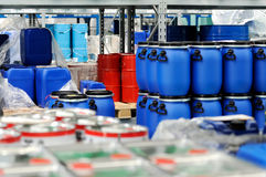 Plastic barrels or drums stored in a warehouse Stock Photo