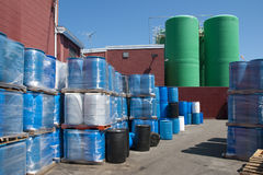 Plastic barrels used to ship chemicals. Industrial plastic drums used to ship fertilizers and chemicals Stock Image