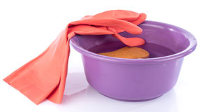 Plastic basin whith gloves and sponge Royalty Free Stock Photo