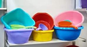 Plastic basins. And scoops in store Stock Images