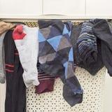 Plastic basket full of socks Royalty Free Stock Photography