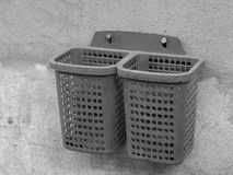 PLASTIC BASKET SCREWED ON CONCRETE WALL Royalty Free Stock Images