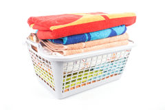 Plastic basket with towels Stock Photo