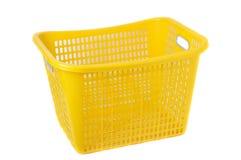 Plastic basket. Yellow plastic basket on white background Stock Photos