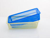 Plastic baskets. Two plastic baskets on a white background Stock Images