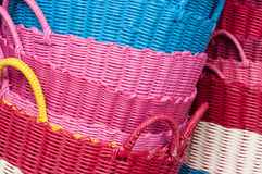 Plastic baskets. Colorful plastic baskets heaped as background Royalty Free Stock Photo