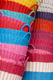 Plastic baskets. Colorful plastic baskets heaped as background Stock Photo