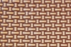 Brown plastic basketwork texture. Stock Photos