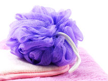 Plastic bath puff and towel Royalty Free Stock Photo
