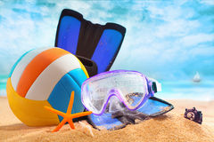 Plastic beach ball with goggles and flippers Royalty Free Stock Image