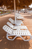 Plastic beach beds on coral bay Royalty Free Stock Image