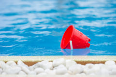 Plastic beach kids toys at the swimming pool on Royalty Free Stock Photography