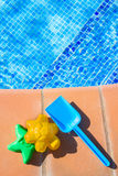Plastic beach toys near pool Royalty Free Stock Image