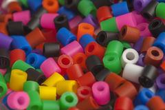 Plastic beads colors. Plastic beads many rainbow colors Royalty Free Stock Photos