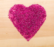 Plastic beads  in heart shaped Stock Photography