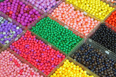 Plastic beads. Various colorful plastic beads in trays Stock Photo