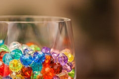 Plastic Beads in a wine glass Royalty Free Stock Photo