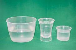 Plastic beakers. Different plastic beakers for measuring liquids Royalty Free Stock Image