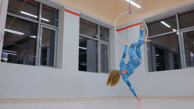 Plastic beautiful girl gymnast on acrobatic circus ring Stock Image