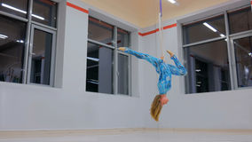 Plastic beautiful girl gymnast on acrobatic circus ring Stock Photo