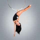 Plastic beautiful girl gymnast on acrobatic circus ring in flesh-colored suit Royalty Free Stock Images