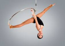 Plastic beautiful girl gymnast on acrobatic circus ring in flesh-colored suit Royalty Free Stock Photography