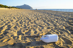 Plastic on bech. Plastic forgotten on a  beautiful italian bech in winter time Stock Photography