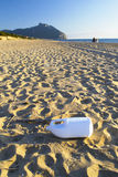 Plastic on bech. Plastic forgotten on a  beautiful italian bech in winter time Royalty Free Stock Image