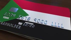 Plastic betaalpas die vlag van de Soedan kenmerken Het systeem verwante animatie van het Sudanian nationale bankwezen stock illustratie