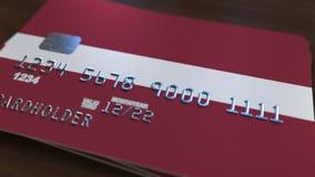 Plastic betaalpas die vlag van Letland kenmerken De Letse nationale verwante animatie van het bankwezensysteem royalty-vrije illustratie