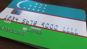 Plastic betaalpas die vlag van Oezbekistan kenmerken De Oezbekistaanse nationale verwante animatie van het bankwezensysteem vector illustratie