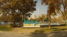 Plastic big letters Konya on the background of minarets in the park in the city center. KONYA / TURKEY - 11.20.2016 central streets of the ancient Turkish city stock footage