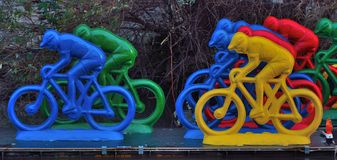 Plastic bikers on a river Stock Photo