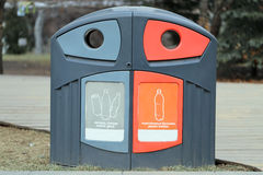 Plastic bin to separate trash Stock Images