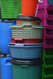 Plastic bins. Buckets and containers for sale at market Stock Image