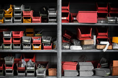 Plastic bins at sorting shelf in warehouse Stock Images