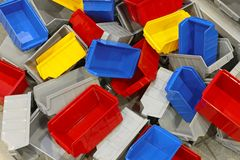 Plastic bins and tubs. Big bunch of colorful plastic sorting bins and tubs stock photography