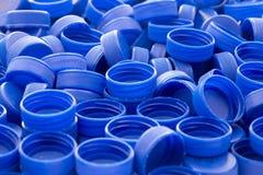 plastic blåa kapsyler Royaltyfri Bild