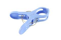 Plastic blå torkdukepinne Arkivbild