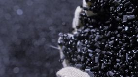 Plastic black gray granulated crumb. Manufacture of plastic water pipes factory. Process of making plastic tubes on the. Plastic black gray granulated crumb stock video footage