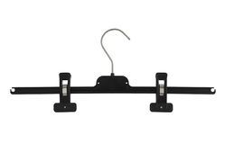 Plastic black pants hanger with pegs Stock Images