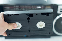 Plastic, black video cassette in the hands Royalty Free Stock Images