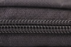 Plastic black zipper of case. Macro. Royalty Free Stock Photos