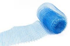 Plastic blauw net voor pleister Stock Foto
