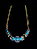 Plastic blue gold necklace. On a black background Royalty Free Stock Photography