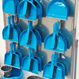 Plastic blue household brushes and scoops in store. Plastic blue household brushes and scoops in the hardware store Royalty Free Stock Image