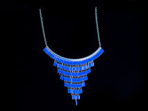 Plastic blue necklace. On a black background Stock Photography