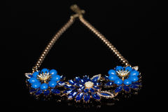 Plastic blue necklace Royalty Free Stock Image