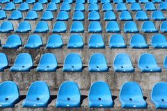 Plastic blue seats on football stadium Stock Photography