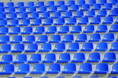 Plastic blue seats. On football stadium Royalty Free Stock Photos